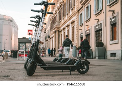 MILAN, ITALY - FEBRUARY 09, 2019: Electric scooters HelbizGO, launched in 2018, people can rent and unlock directly from their phone