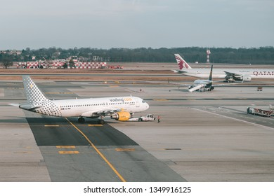 MILAN, ITALY - FEBRUARY 09, 2019: Vueling Airlines EC-MBY (Airbus A320 parked in Milan Malpensa Airport. It is the largest international airport in the Milan metropolitan area in northern Italy