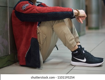 Milan, Italy - February 10, 2018: Young man wearing a pair of Nike Air Max Lunar Force and a Napapijri fleece