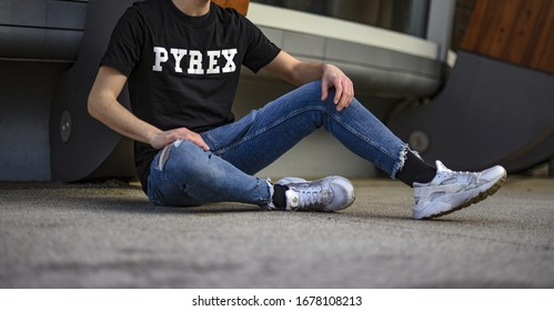 Milan, Italy - February 11, 2018: teenager wearing Pyrex t-shirt and a pair of white Nike Huarache on the street