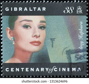 Milan, Italy – February 11, 2019: Beauty of Audrey Hepburn on postage stamp