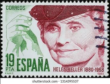 Milan, Italy – February 11, 2019: Portrait of Helen Keller on spanish stamp