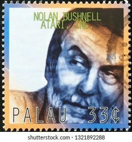 Milan, Italy – February 11, 2019: Nolan Bushnell, founder of Atari Inc. on postage stamp