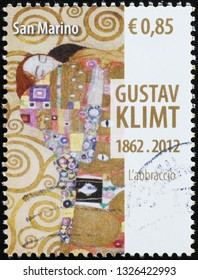Milan, Italy – February 11, 2019: Detail from the Embrace by Klimt on postage stamp