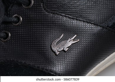 Milan, Italy - February 14, 2017: Closeup of Lacoste brand Shoes. Lacoste a french company for the production of clothing, shoes, perfumes, leather goods.