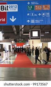 MILAN, ITALY - FEBRUARY 16: People enter exhibition area during BIT, International Tourism Exchange Exhibition on February 16, 2012 in Milan, Italy.