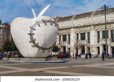 Milan, Italy - February 17 2017: The Reintegrated Apple sculpture by Michelangelo Pistoletto. 11 tons giant whit apple with steel stitching at Piazza Duca dâ Aosta Milano at Centrale train station.