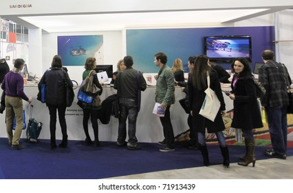 MILAN, ITALY - FEBRUARY 17: People visit tourism stands at Italy showtrade pavilion during BIT, International Tourism Exchange Exhibition on February 17, 2011 in Milan, Italy.