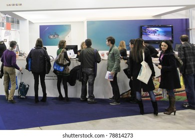 MILAN, ITALY - FEBRUARY 17: People visiting international tourism exhibitions stand at BIT, International Tourism Exchange Exhibition on February 17, 2011 in Milan, Italy.