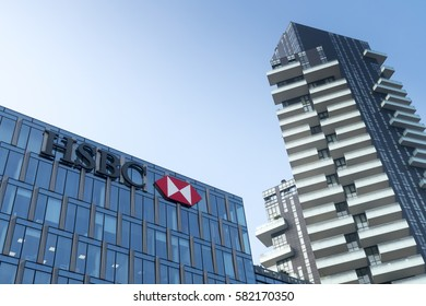 Milan, Italy - February 18, 2017: HSBC sign and logo on headquarters building in Milan, Italy.