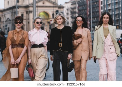 Milan, Italy - February 20, 2019: Street style outfits - models, bloggers and influencers before a fashion show during Milan Fashion Week - MFWFW19