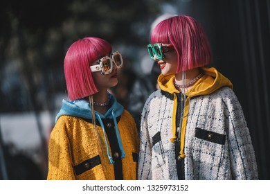 Milan, Italy - February 20, 2019: Street style outfits - Ami Suzuki and Aya Suzuki before a fashion show during Milan Fashion Week - MFWFW19