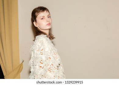 MILAN, ITALY - FEBRUARY 20: Gorgeous model poses in the backstage just before Alberto Zambelli show during Milan Women's Fashion Week on FEBRUARY 20, 2019 in Milan.