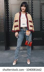 Milan, Italy - February 21, 2018: Asian girl posing during Milan Fashion Week.
