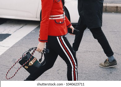 Milan, Italy - February 21, 2018: Woman with Gucci outfit during Milan fashion Week.