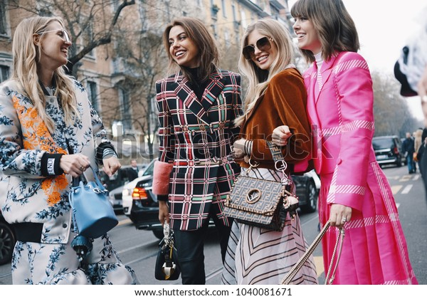 Milan, Italy - February 21, 2018: Models, bloggers and influencers with fashionable and stylish looking during Milan Fashion Week.