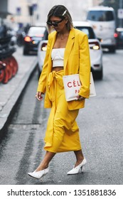 Milan, Italy - February 21, 2019: Street style – Woman wearing a Celine handbag before a fashion show during Milan Fashion Week - MFWFW19
