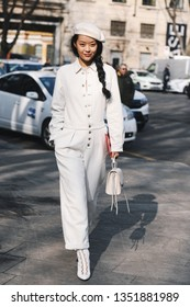 Milan, Italy - February 21, 2019: Street style – Woman wearing a jumpsuit before a fashion show during Milan Fashion Week - MFWFW19