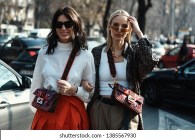 Milan, Italy - February 21, 2019: Street style – Women wearing Fendi after a fashion show during Milan Fashion Week - MFWFW19