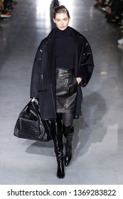 MILAN, ITALY - FEBRUARY 21: Grace Elizabeth walks the runway at the Max Mara show at Milan Fashion Week Autumn/Winter 2019/20 on February 21, 2019 in Milan, Italy.