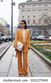 Milan, Italy - February 22, 2018: Girl with fashionable outfit posing after Max Mara show during Milan Fashion Week.
