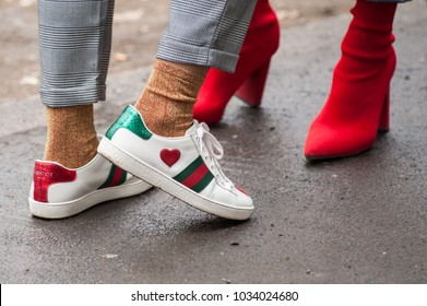 MILAN, ITALY - FEBRUARY 22, 2018: Stylish person posing in Gucci shoes outside FENDI during Milan Fashion Week Fall/Winter 2018/19 on February 22, 2018 in Milan, Italy.
