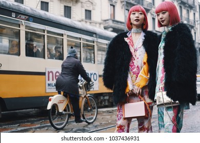 Milan, Italy - February 22, 2018: Identical japanese twins Amy and Aya, fashion influencers during Milan Fashion Week - street style concept