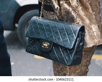 Milan, Italy - February 22, 2018: Fashionable girl wearing a Chanel luxury bag during Milan Fashion street - street style concept
