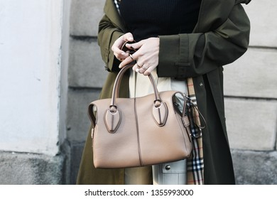 Milan, Italy - February 22, 2019: Street style – Influencer Xenia Adonts wearing a Burberry coat before a fashion show during Milan Fashion Week - MFWFW19