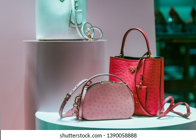Milan, Italy – February 22, 2019:  Prada leather handbags in a luxury store in Milan, February 2019.