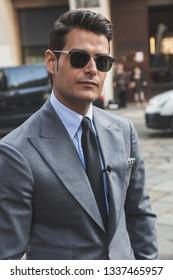 MILAN, ITALY - FEBRUARY 22: Fashionable man poses outside Blumarine fashion show during Milan Women's Fashion Week on FEBRUARY 22, 2019 in Milan.