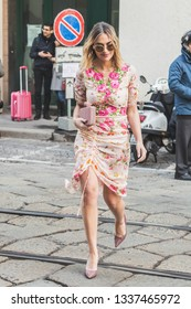 MILAN, ITALY - FEBRUARY 22: Fashionable woman poses outside Blumarine fashion show during Milan Women's Fashion Week on FEBRUARY 22, 2019 in Milan.