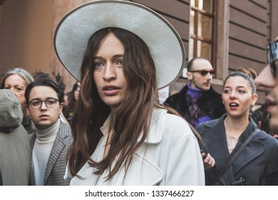MILAN, ITALY - FEBRUARY 22: Fashionable woman poses outside Blumarine fashion show during Milan Women's Fashion Week on FEBRUARY 22, 2019 in Milan.