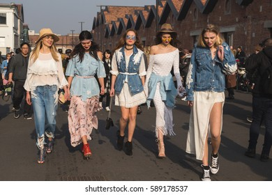 MILAN, ITALY - FEBRUARY 22: Fashionable women pose outside Gucci fashion show building during Milan Women's Fashion Week on FEBRUARY 22, 2017 in Milan.