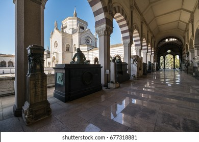MILAN, ITALY - FEBRUARY 23, 2017: The Cimitero Monumentale (Monumental Cemetery) is one of the two largest cemeteries in Milan, Italy. It is noted for the abundance of artistic tombs and monuments.