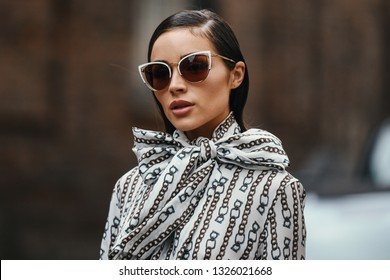 Milan, Italy - February 23, 2019: Street style - Girl with a stylish look posing before a fashion show during Milan Fashion Week - MFWFW19