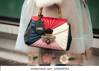 MILAN, ITALY - FEBRUARY 24, 2018: Stylish person posing with GUCCI bag outside Armani during Milan Fashion Week Fall/Winter 2018/19 on February 24, 2018 in Milan, Italy.