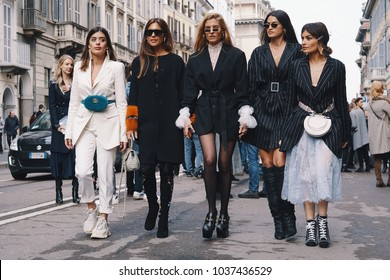 Milan, Italy - February 24, 2018: Fashionable models, bloggers and influencers posing and walking on the street after Ermanno Scervino show during Milan Fashion Show.