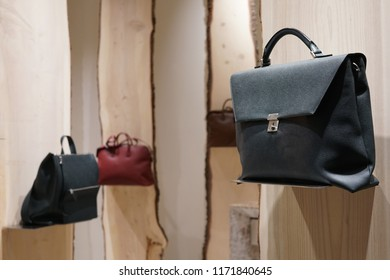 Milan, Italy - February 24, 2018: Leather bags and handbags in a fashion store in Milan