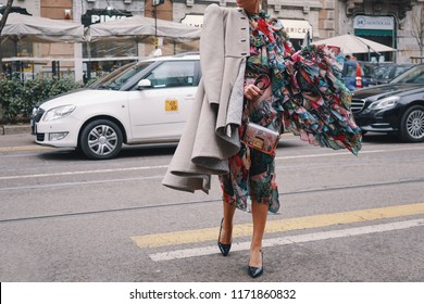 Milan, Italy - February 24, 2018: Extravagant outfit of a influencer outside a fashion show, posing during Milan Fashion Week.