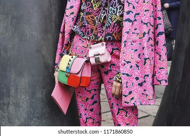 Milan, Italy - February 24, 2018: Fashion influencer wearing an urban outfit, posing on the street during Milan Fashion Week.
