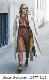 Milan, Italy - February 24, 2019: Street style – woman wearing a Christian Dior purse after a fashion show during Milan Fashion Week - MFWFW19