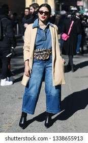 Milan, Italy - February 24, 2019: Street style – Denim jumpsuit before a fashion show during Milan Fashion Week - MFWFW19