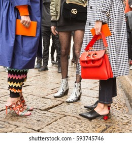 MILAN, ITALY - FEBRUARY 24: Fashionable women pose outside Sportmax fashion show during Milan Women's Fashion Week on FEBRUARY 24, 2017 in Milan.