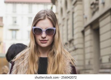 MILAN, ITALY - FEBRUARY 25: Beautiful model poses outside Gucci fashion show building for Milan Women's Fashion Week on FEBRUARY 25, 2015  in Milan.