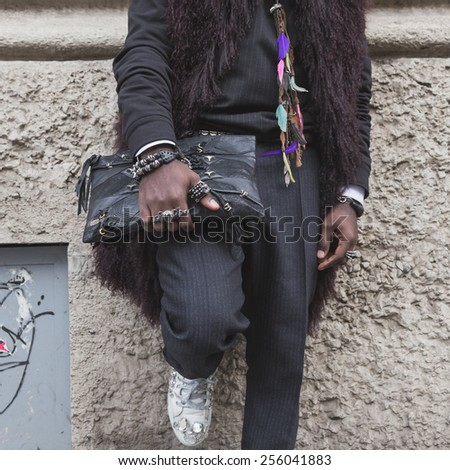9164de47 MILAN, ITALY - FEBRUARY 25: Detail of a man with bag outside Gucci fashion