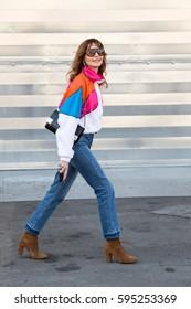 MILAN, ITALY - FEBRUARY 25: Fashionable woman poses outside Antonio Marras fashion show during Milan Women's Fashion Week on FEBRUARY 25, 2017 in Milan.