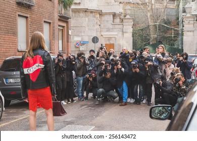 MILAN, ITALY - FEBRUARY 25: People gather outside Alberta Ferretti fashion show building for Milan Women's Fashion Week on FEBRUARY 25, 2015  in Milan.