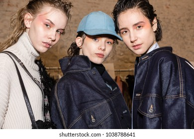 MILAN, ITALY - FEBRUARY 26: Gorgeous models pose in the backstage just before Ujoh show during Milan Women's Fashion Week on FEBRUARY 26, 2018 in Milan.