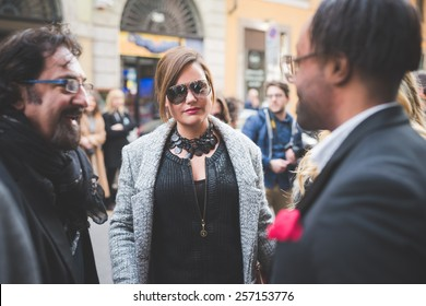 MILAN, ITALY - FEBRUARY 27: People during Milan Fashion week, Italy on February, 27 2015. Eccentric and fashionable people outside city during Milan fashion week wait for models and famous people